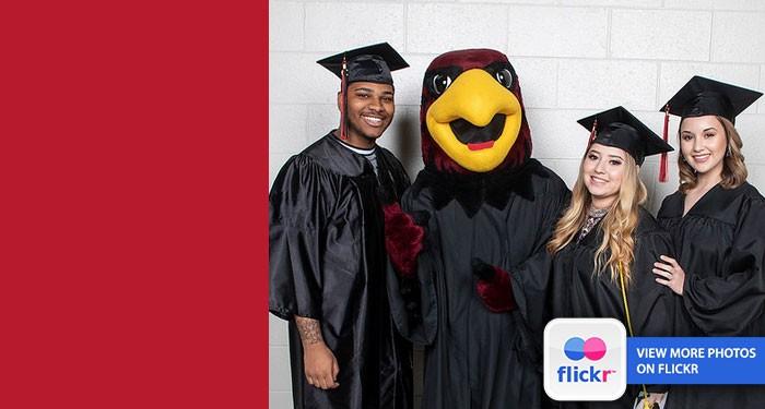 Recent graduates celebrate with Rudy