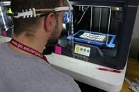 Person using a 3D printer