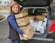 Vicki Hulback loading medical suppies to donate