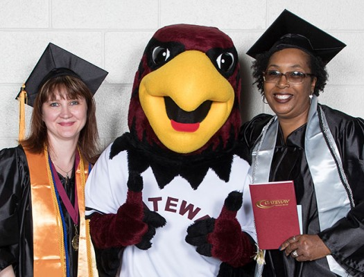 Honors Graduates with Rudy the Red Hawk