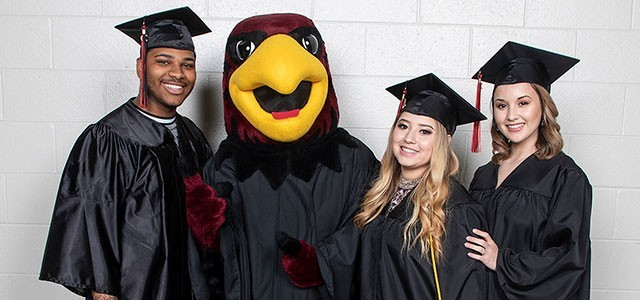 Rudy the Red Hawk with graduates